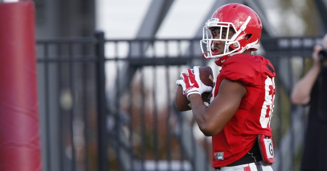 UGA wide receiver Michael Chigbu (82) looks on during drills at Thursday's practice. (Joshua L. Jones/Special)