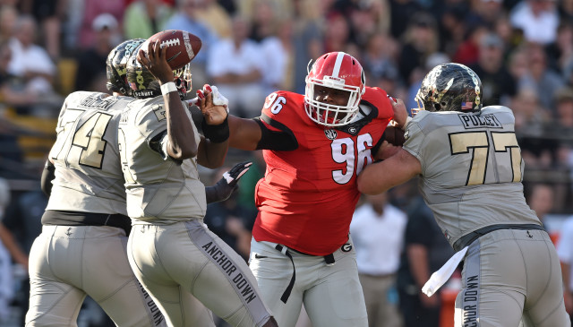 Despite the double team by Vanderbilt offensive tackle Will Holden and center Spencer Pulley, UGA defensive tackle DaQuan Hawkins was able to pressure Vanderbilt quarterback Johnny McCrary out of the pocket during the second half. (Brant Sanderlin/ AJC)