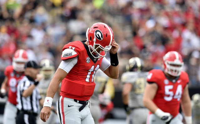 UGA quarterback Greyson Lambert walks off the field after throwing an incomplete pass, bringing up 4th down against Vanderbilt. (Brant Sanderlin/ AJC)
