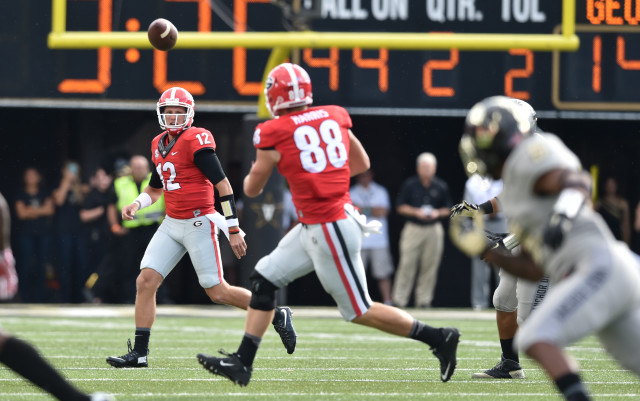 UGA quarterback Brice Ramsey watches his pass find tight end Jackson Harris late in the first half against Vanderbilt. (Brant Sanderlin/ AJC)