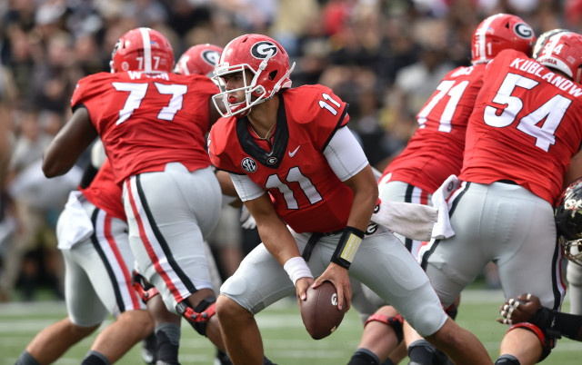 Georgia Bulldogs quarterback Greyson Lambert turns to pitch the ball against Vanderbilt in the first half. The running game was effective for the Bulldogs in the first half. (Brant Sanderlin/ AJC)