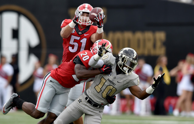 UGA linebacker Jake Ganus couldn't come up with the interception after teammate Quincy Mauger knocked the ball from Vanderbilt wide receiver Trent Sherfield during the first half. (Brant Sanderlin/ AJC)