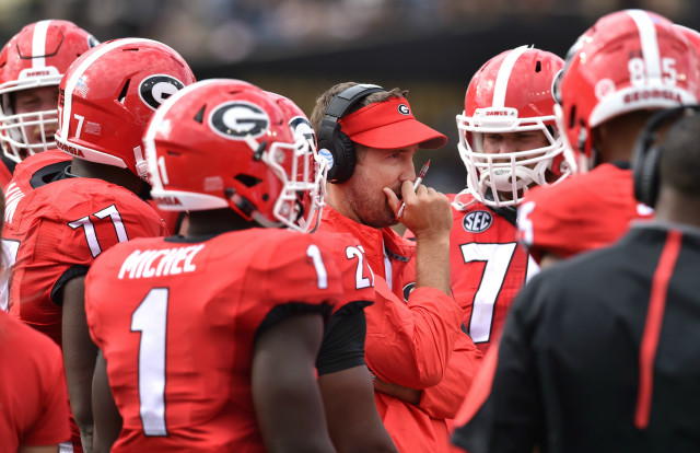 UGA offensive coordinator Brian Schottenheimer talks during a timeout against Vanderbilt. (Brant Sanderlin/ AJC)