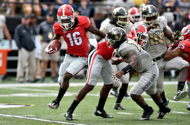 UGA punt returner Isaiah McKenzie looks for running room in the first half. McKenzie retuned a first quarter punt for a 77-yard touchdown against Vanderbilt. (Brant Sanderlin/ AJC)