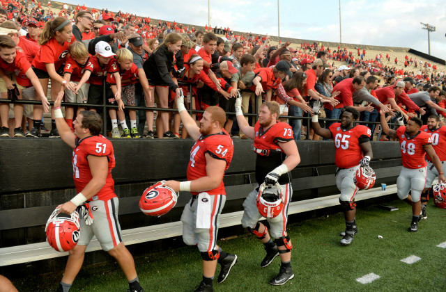 UGA celebrates the win over Vanderbilt  with fans who made the trip to Nashville. (Brant Sanderlin/ AJC)