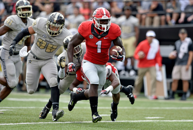 UGA running back Sony Michel en route to a 31-yard first half touchdown against Vanderbilt. (Brant Sanderlin/ AJC)