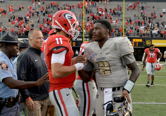UGA quarterback Greyson Lambert and Vanderbilt quarterback Johnny McCrary greet each other following the Bulldog win. (Brant Sanderlin/ AJC)