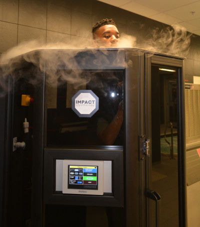 Georgia's Reggie Wilkerson peers out of the top of one of UGA's new cryotherapy chambers. UGA