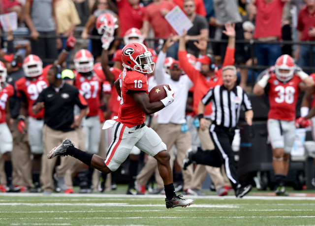 UGA punt returner Isaiah McKenzie returns a punt for a touchdown against Vanderbilt. (Brant Sanderlin/ AJC)