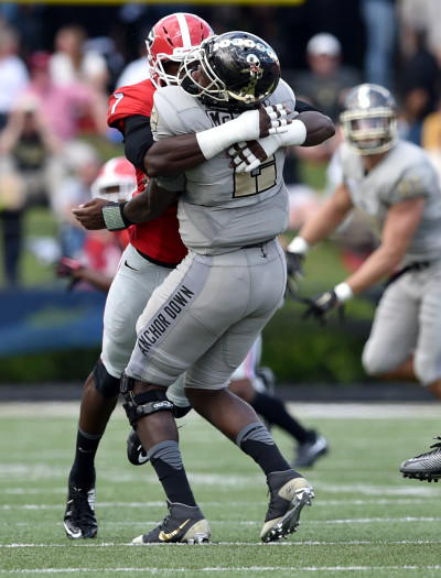 Sophomore outside linebacker Lorenzo Carter was ejected for this hit on Vanderbilt quarterback Johnny McCrary. AJC / BRANT SANDERLIN