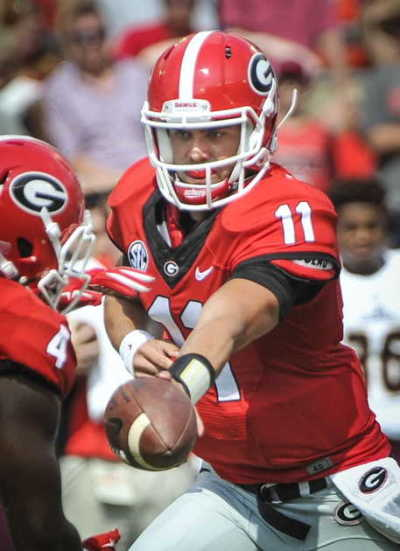 Greyson Lambert is loving the plethora of play-makers at his disposal at Georgia. AP / JOHN AMIS