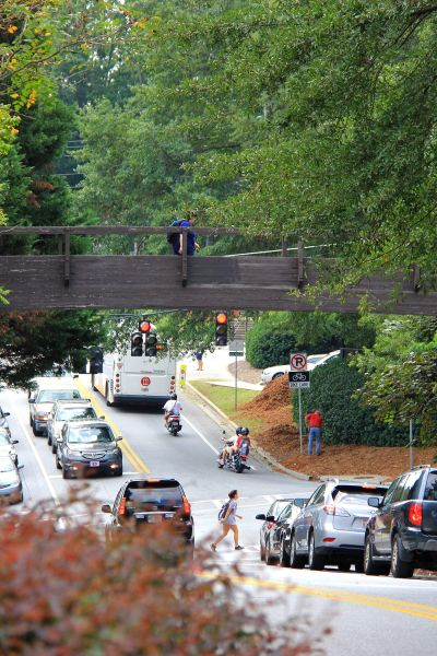 A pedestrian crosses the Thomas Street bridge on Aug. 3, 2015. The bridge has been closed as the result of a structural analysis and will be replaced.